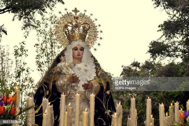 Statue of the Virgin of the Remedies during of procession of 15 1 Brotherhood in L´Hospitalet City The 15 1 brotherhood of L'Hospitalet City has...