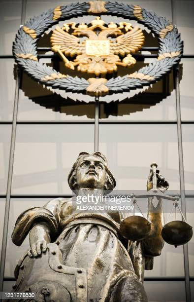 Statue of Themis, an ancient Greek Goddess of Justice and a Russian national state emblem are seen at the entrance of Russia's Supreme Court in...