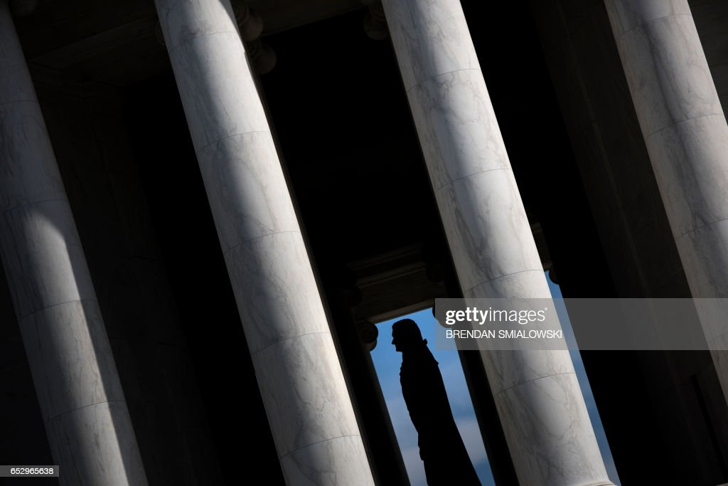 A statue of Thomas Jefferson is seen in the Jefferson Memorial on the National Mall on March 13, 2017 in Washington, DC. / AFP PHOTO / Brendan Smialowski
