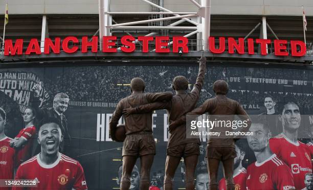 Statue of United Trinity, the trio of George Best, Denis Law and Sir Bobby Charlton is seen prior to the Premier League match between Manchester...