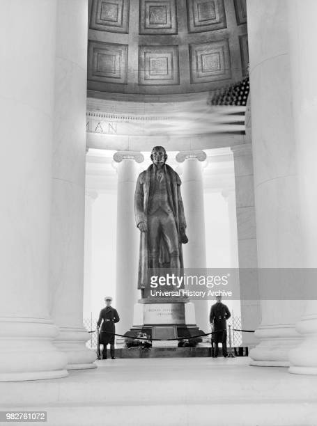 Statue of US President Thomas Jefferson flanked by Marine Honor Guards during Jefferson Memorial dedication Washington DC USA Ann Rosener for Office...
