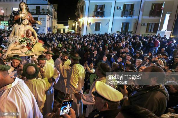 A statue of Virgin Mary is carried during a procession on Holy Friday in Nocera Terinese in the Calabria region of southern Italy The procession is...