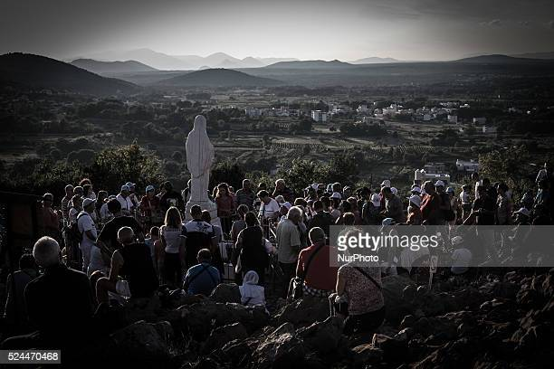 A statue of Virgin Mary on the the Apparition Hill in Medjugorie Almost one million people visit Medjugorje each year where the Virgin Mary is said...