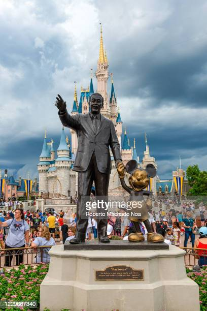 Statue of Walt Disney and Mickey Mouse at the Magic Kingdom theme park.