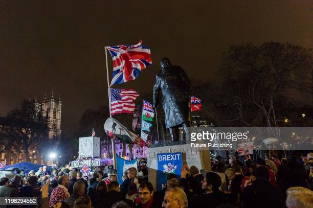 Statue of Winston Churchill is surrounded by thousands of pro-Brexit supporters taking part in a rally celebrating Britain's departure from the EU in...
