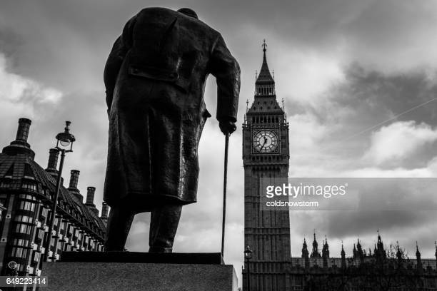 statue of winston churchill overlooking big ben and houses of parliament, london, uk - winston churchill stock photos and pictures