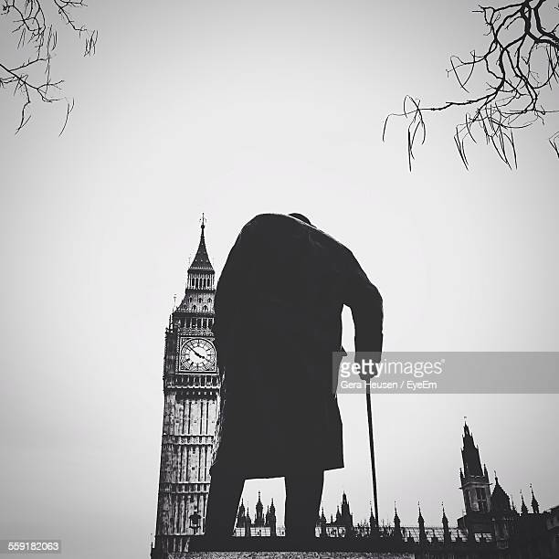 statue of winston churchill with big ben - famous people stock photos and pictures