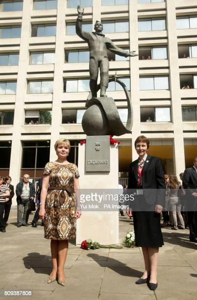 A statue of Yuri Gagarin the first man in space is unveiled by the cosmonaut's daughter Elena Gagarina Director of the Kremlin Museums in Moscow and...