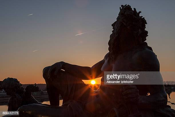 CONTENT] Statue of Zeus with sunset shining through under his arm at the Castle garden in Versailles France 2014