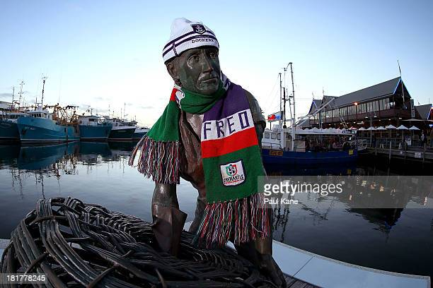 A statue on Fisherman's Landing is pictured wearing a Dockers scarf and beanie on September 25 2013 in Fremantle Australia The Fremantle Dockers play...