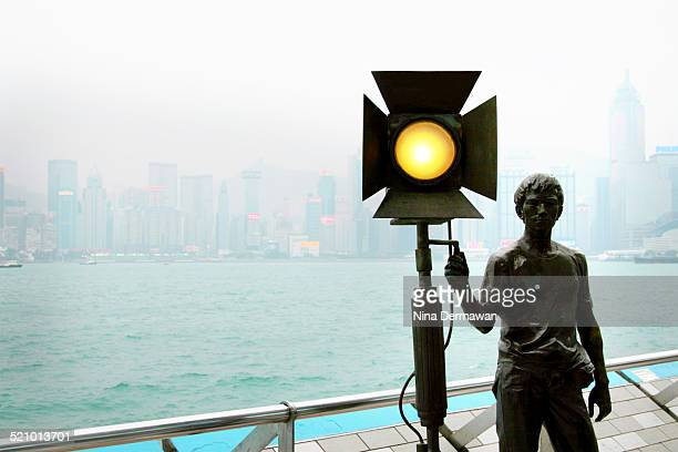 A statue on The Avenue of Stars modelled on the Hollywood Walk of Fame Tsimshatsui The Avenue of Stars honours celebrities of Hong Kong film industry