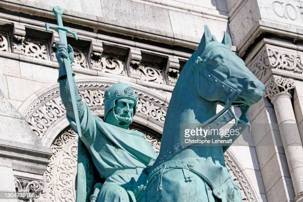 statue on the facade of the basilica of the sacred heart, paris - weaponry stock pictures, royalty-free photos & images