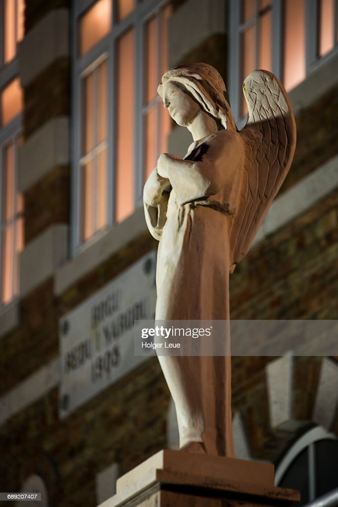 Statue outside monastery at night : Stock Photo