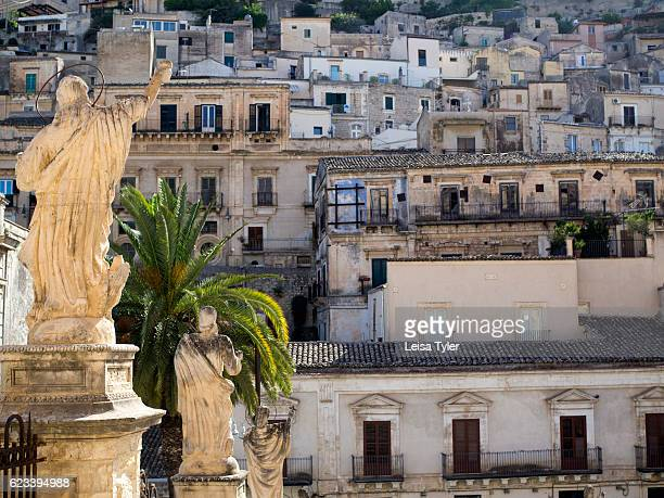 A statue outside the church of St Peter or San Pietro in Modica a Baroque town with World Heritage status in Sicily
