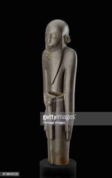 Statue Predynastic Period circa 3100 BC Standing man arms by sides with hands open palms in legs together Details of eyes eyebrows and mouth clearly...
