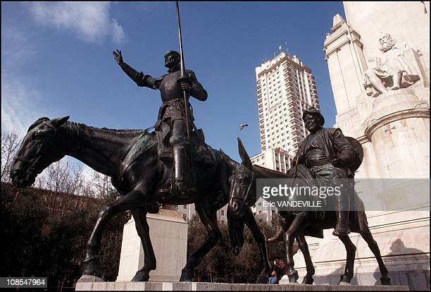 A statue representing Don Quixote Sancho Panza and Cervantes on the Plaza d¹Espana in Madrid in Spain in January 2000