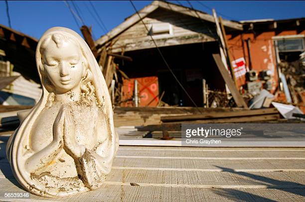 A statue sits in front of a home damaged by Hurricane Katrina on January 7 2006 in New Orleans Louisiana The New Orleans City council has agreed to...