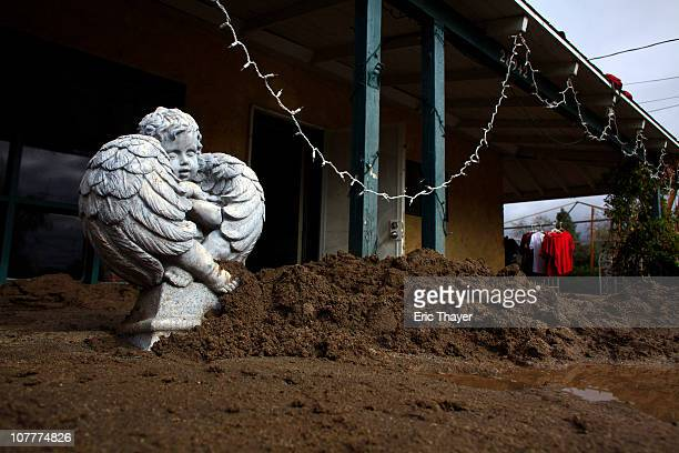 A statue stands in front of a flooded house December 23 2010 in Highland California Residents throughout southern California were hit hard by storms...