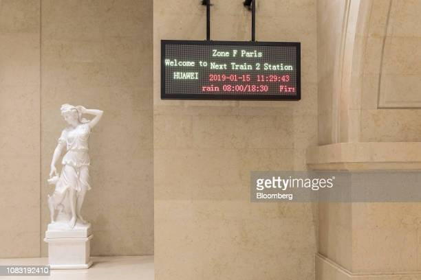 A statue stands next to an information board at the Paris train station at Huawei Technologies Co new campus in Dongguan China on Tuesday Jan 15 2019...