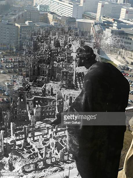 This digital composite image shows a statue on the tower of City Hall looking down at the ruins of the city center wrought by the Allied firebombing...