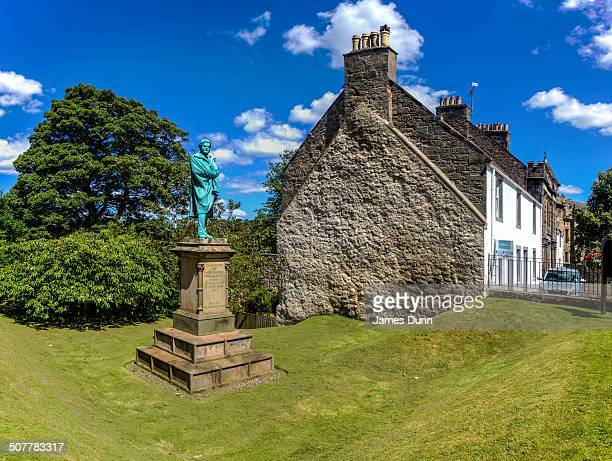 Statue to Onesiphorus Tyndall 1790 to 1855 in the grounds of he Church of Scotland, Falkland, Fife, Scotland who was born in Bristol, England where...