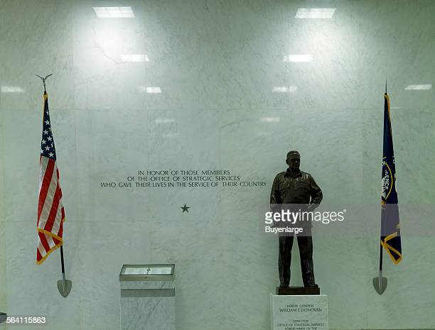 Statue to William Donovan director of the CIA predecessor agency and a marker to the CIA fallen at Central Intelligence Agency headquarters Langley...