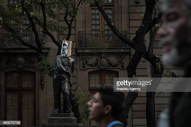 A statue with the face of Enrique Pena Nieto President of Mexico is seen during a protest staged to demand the appearance of the life of 43 missing...