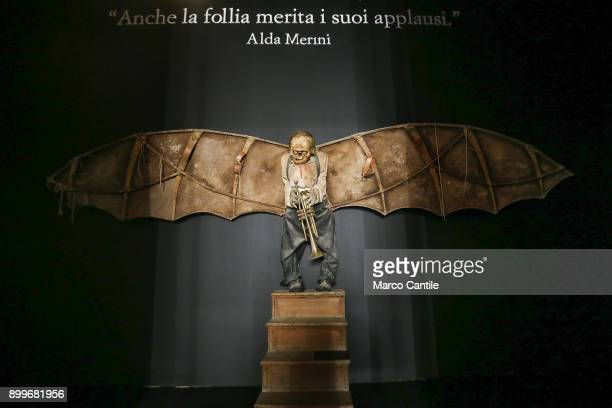 A statue with the inscription of the poet Alda Merini even the pumite madness her applause in the museum of madness
