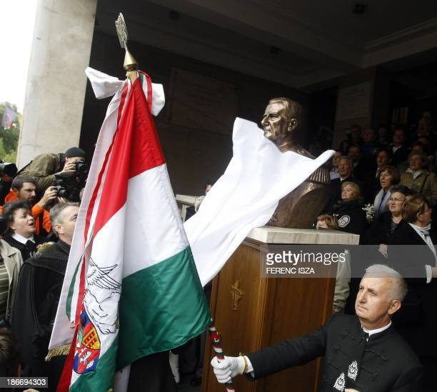 A statuebust of Hungary's wartime leader Miklos Horthy is being unveiled in Budapest on November 3 2013 The unveiling provoked protests of...