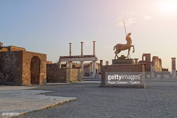statues and old ruins against sky at pompeii - pompeii stock photos and pictures