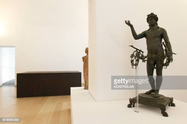MUSEUM NAPLES CAMPANIA ITALY Statues are displayed near the work of Richard Serra in the exibition Pompei@madre in the Madre Museum of Contemporary...