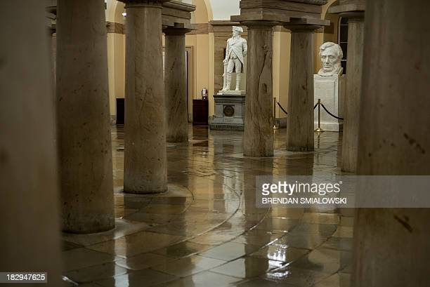 Statues are seen in the crypt of the deserted Capitol Building -- a normal stop for tourists -- on October 2, 2013 in Washington, DC. The White House...