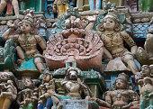 Statues around two Dwarapalakas.