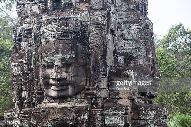 Statues at Bayon Temple Angkor Thom on March 15 2012 in Siem Reap Cambodia