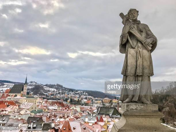 statues at the plášťový most and the town, czech republic - vsojoy stock pictures, royalty-free photos & images