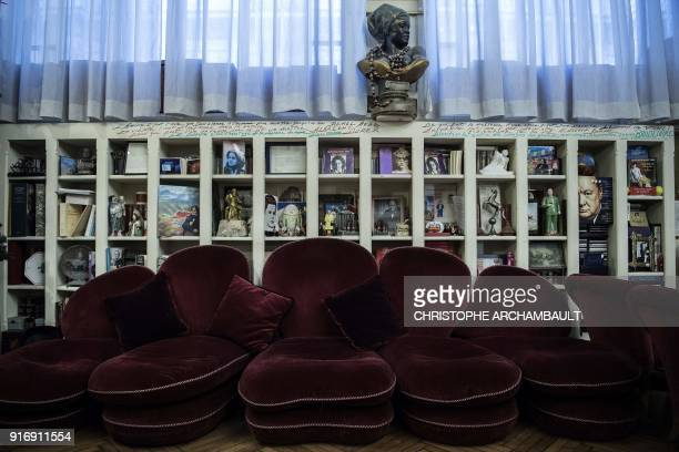 Statues books and various objects are seen in the livingroom of the late French writer Gonzague SaintBris' flat in Paris on January 22 2018 / AFP...