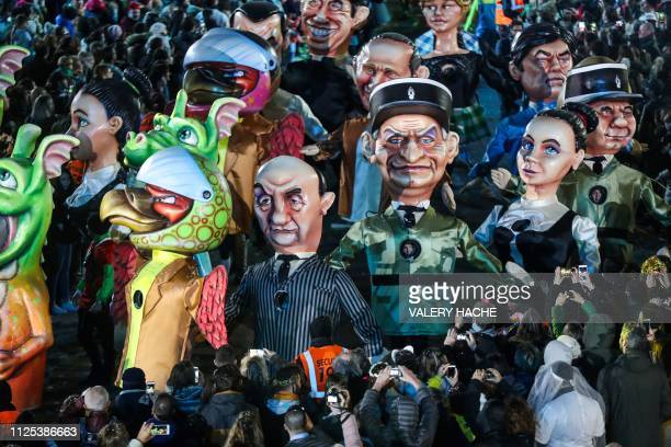Statues depicting French famous actors Louis de Funes Bernard Blier Alain Delon and others parade on the first day of the 135th Nice Carnival which...