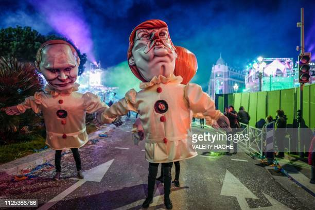 Statues depicting US President Donald Trump and Russia's Vladimir Putin as evil clowns parade on the first day of the 135th Nice Carnival which runs...