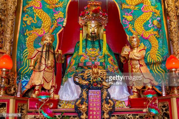 statues from the altar of the guandi temple in kuala lumpur, malaysia - 南東 ストックフォトと画像