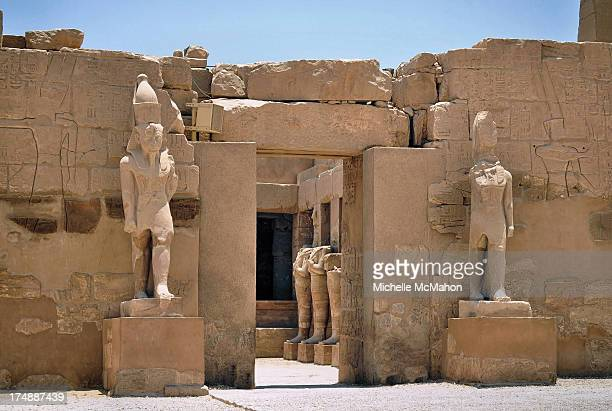 Statues guarding a doorway at the vast Temple complex of Karnak in Luxor, Egypt