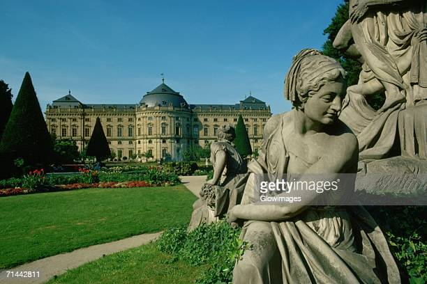 Statues in front of a building, Wurzburg, Germany