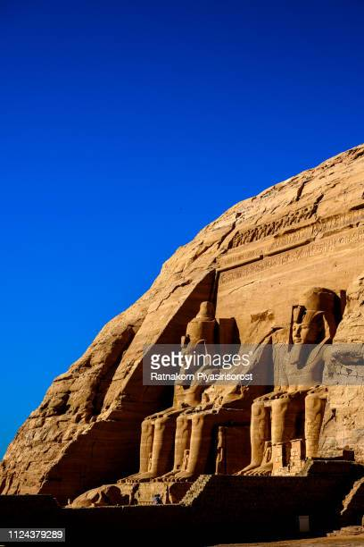 statues in front of abu simbel temple in aswan egypt - cairo stock pictures, royalty-free photos & images