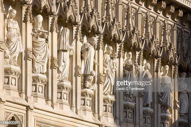 statues of 20th century christian martyrs above great west door of westminster abbey, city of westminster. - westminster abbey stock pictures, royalty-free photos & images