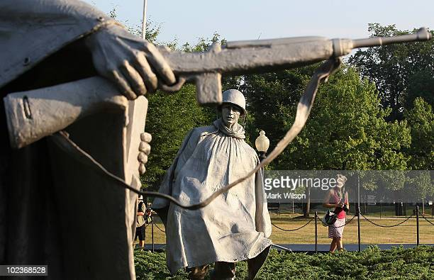 Statues of American soldiers stand at the Korean War Memorial on June 24 2010 in Washington DC Sixty years ago today North Korean troops marched...