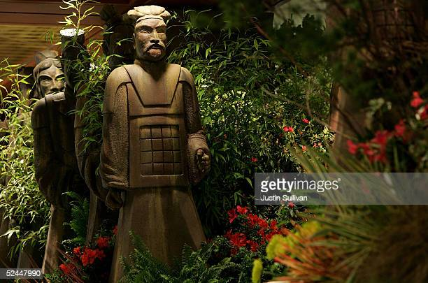 Statues of ancient Chinese warriors are seen in a floral display at Macy's March 18 2005 in San Francisco California Macys Union Square store is...