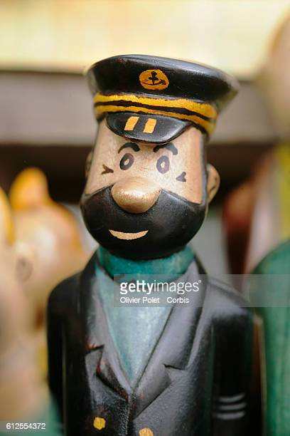 Statues of Captain Haddock and other characters from the comic strip Tintin for sale in front of Hotel Memling in Kinshasa's city center