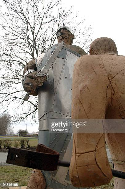 Statues of David and Goliath symbolizing a town's plight against a mining company are seen in Heuersdorf Germany Tuesday March 28 2006 The town is...