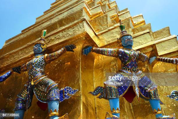 Statues of demons stand within the Grand Palace complex on April 8 2012 in Bangkok Thailand The Grand Palace has served as the official residence of...