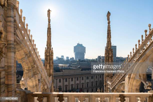 statues of duomo cathedral, milan, italy. - spire stock pictures, royalty-free photos & images