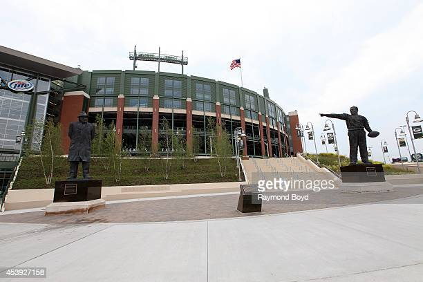 Statues of Earl L Lambeau and Vince Lombardi sits in Harlan Plaza at Lambeau Field home of the Green Bay Packers football team on August 16 2014 in...